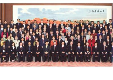 Chinese Premier Wen Jiabao, seated at centre wearing a red tie, photographed with the 50 Award winners and their partners.