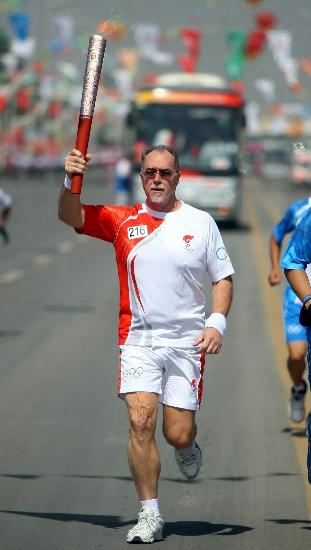 Martin Wragge was honoured to be invited to run with the Olympic Torch through the streets of Yinchuan as the torch made its way to Beijing for the 2008 Summer Olympics